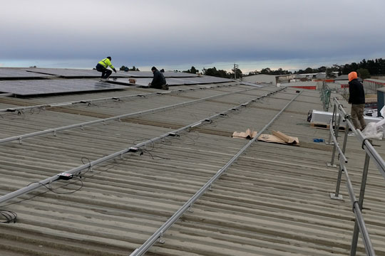 Solar panels being installed on Dyers depot roof